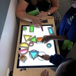 Knights Stream School students with shapes on a lightbox