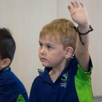 boy with hand in the air